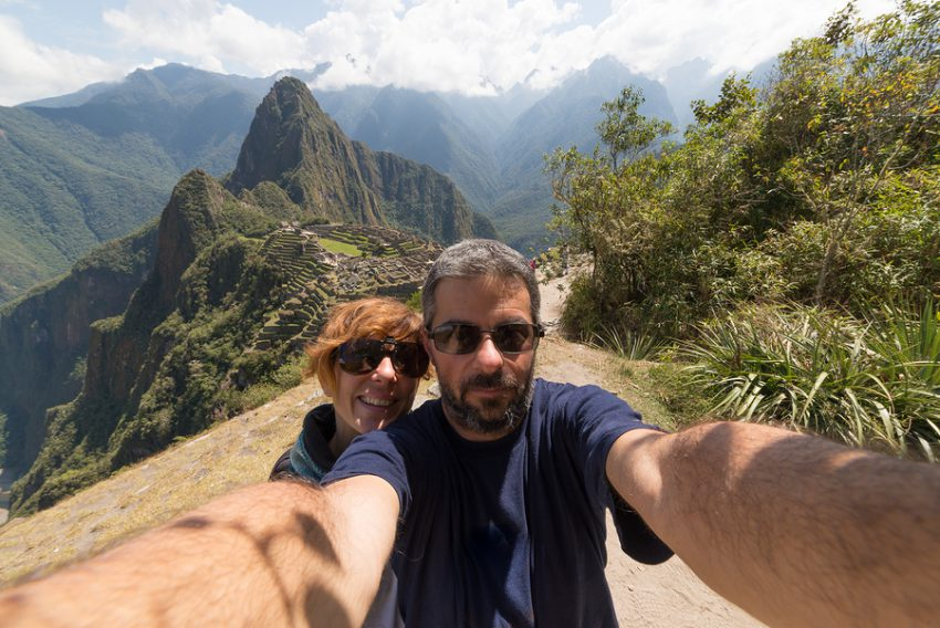 Couple taking selfie on the terraces above Machu Picchu the most visited travel destination in Peru.