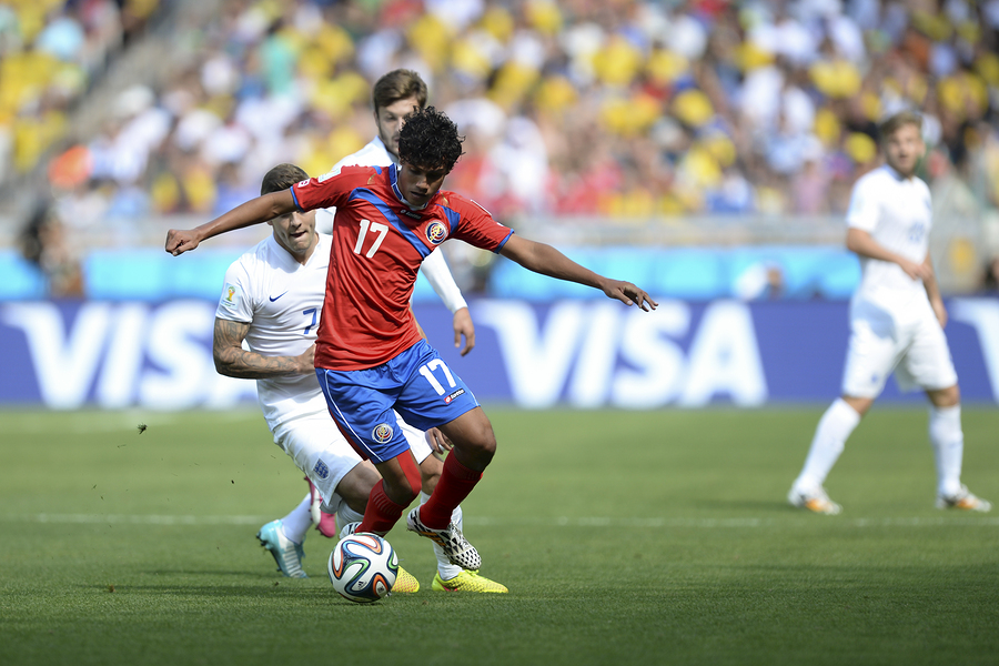 BELO HORIZONTE BRAZIL - June 24 2014: Yeltsin TEJEDA of Costa Rica kicks the ball during the World Cup Group D game between Costa Rica and England at Estadio Mineirao.