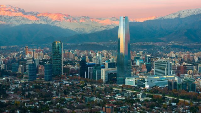 Panoramic view of Providencia and Las Condes districts with The Andes Mountain Range at sunset, Santiago de Chile