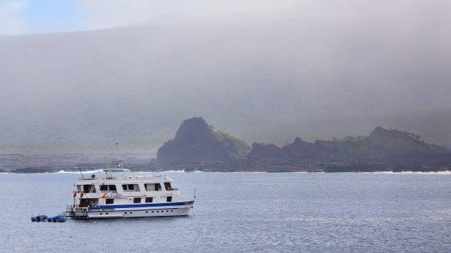 Tourist yacht anchored near Santiago Island on Galapagos National Park, Ecuador.