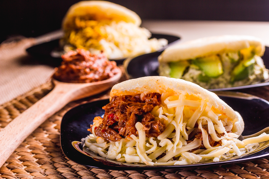 Different types of arepas, meat, black beans, cheese, typical South American food