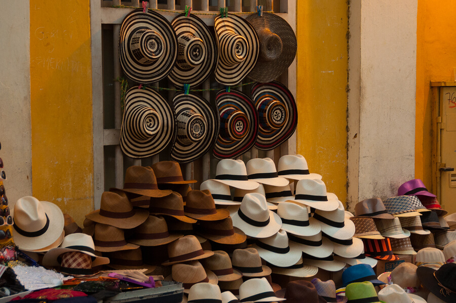 A picture of hats for sale in a Colombian street.