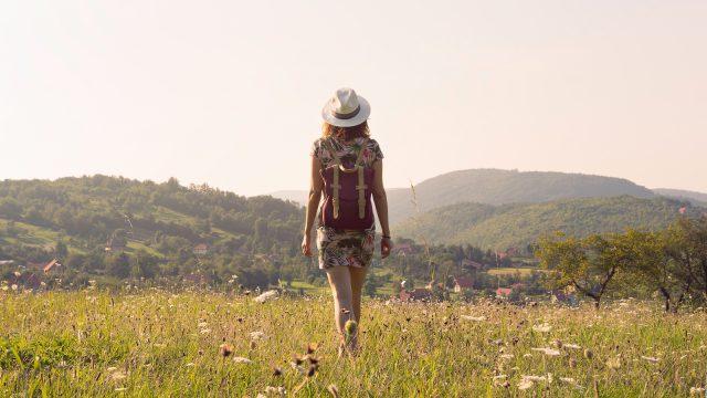 Traveler girl walking through fields in South America.