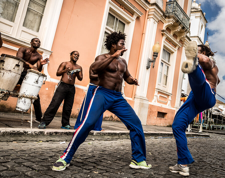 People play music and dance in the street in Rio.