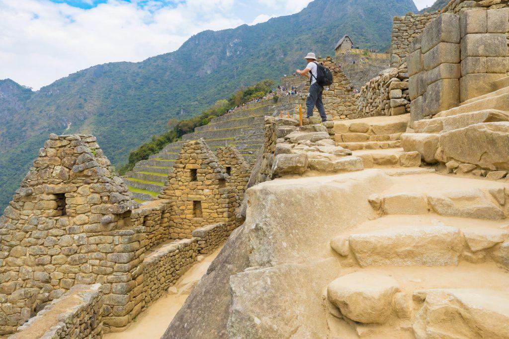 A tourist taking a picture in Machu Picchu.