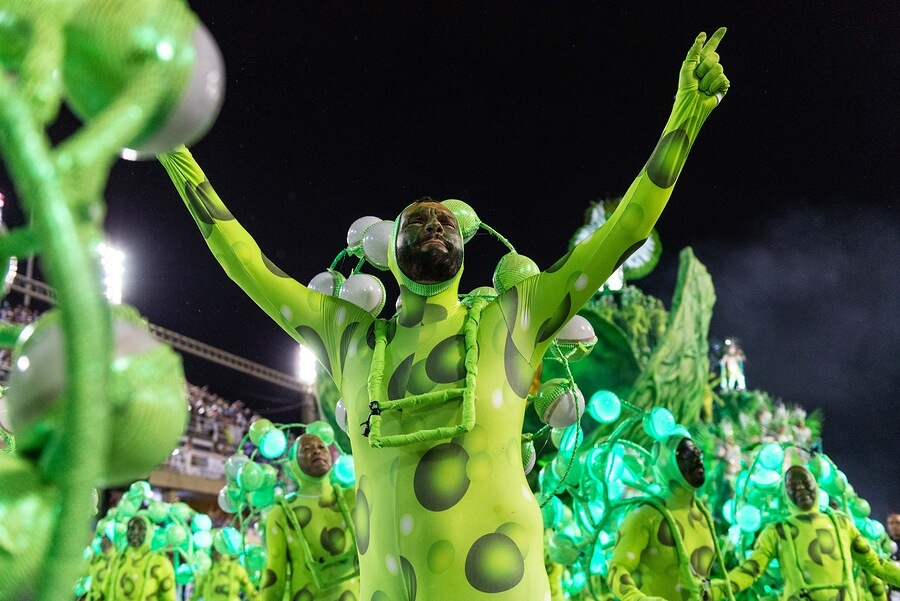 A male dancer dressed in green enjoys the Rio Carnival in 2019.